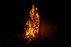 Bonfire and House fire in the night