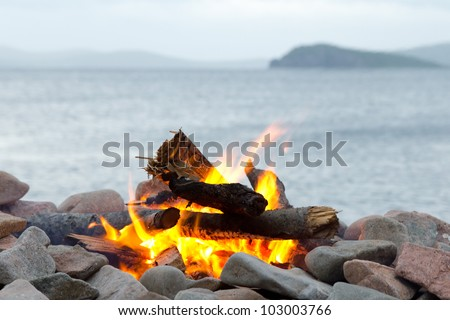 Bonfire in the background of the sea
