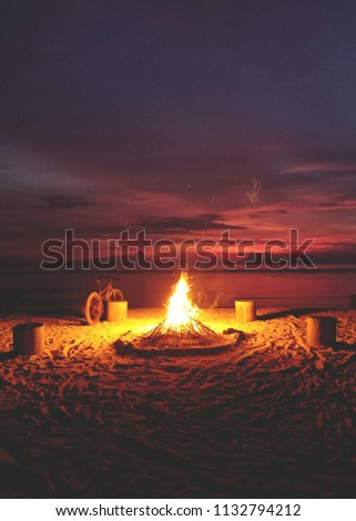 Stock Photo Bonfire on a beach in Gili Trawangan Island in Lombok, Indonesia with a modern style touch