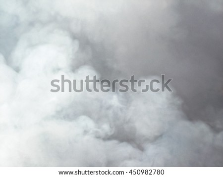Bonfire smoke billowing into the sky creating a soft fluffy background. stock photo