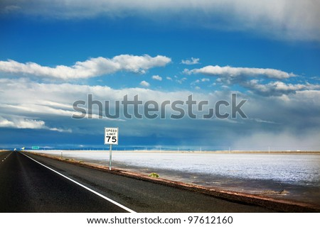 Bonneville Salt Flats, Utah highway road with 75 MPH Speed Limit sign at dusk