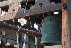 Bonsho (The Buddhist bell) hanging at the bell tower with the beam suspended on ropes in the Buddhist temple of Kyoto. Japan