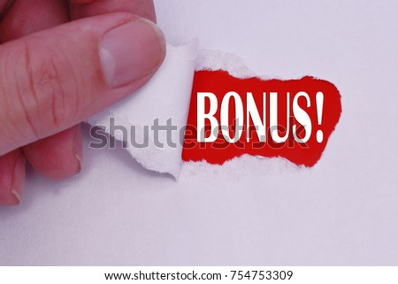 BONUS written under torn white paper #754753309