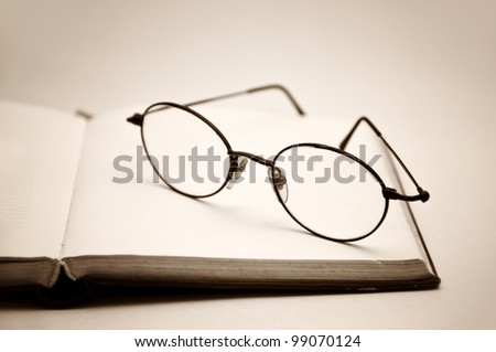 Book and glasses symbolizing the concept of reading habit or studying