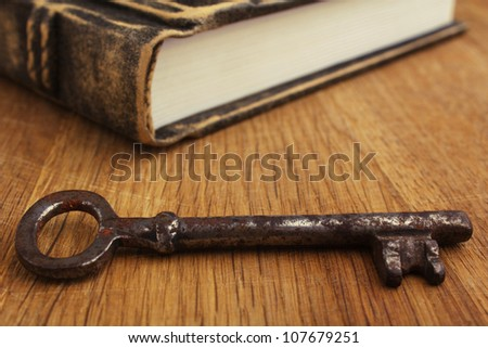 book and key on wood