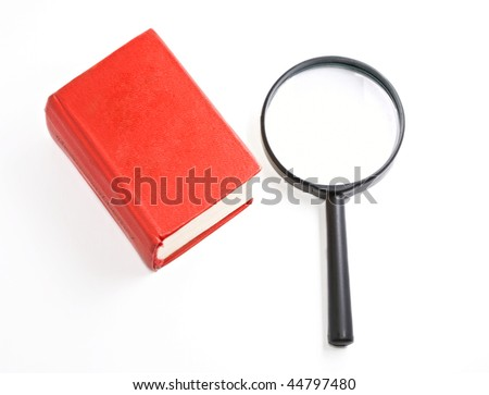 Book and magnifying glass isolated on the white background