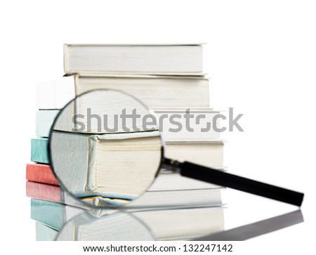 Book and magnifying glass isolated  on white. Search concept