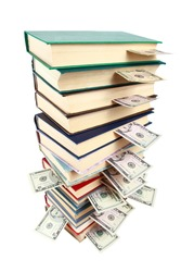 Book and money isolated on white