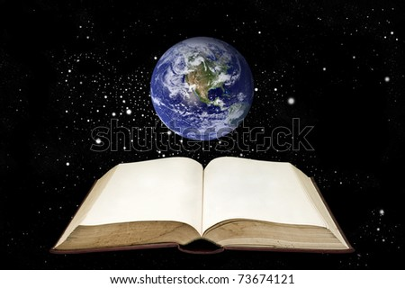 Book and the earth in the space area - stock photo