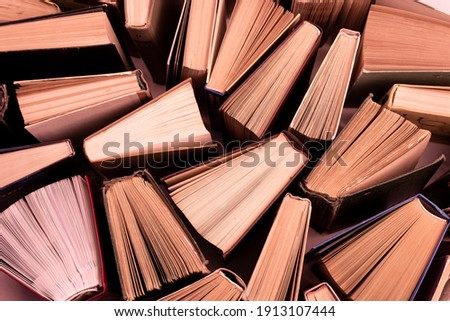 Book background. Old books in the library. Bookshelf shop. Knowledge publications, literature. Bookish bookstore, bookshop. Flatlay top view. Stockfoto ©