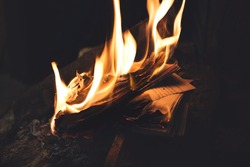Book burning in flames, old memories vanished forever, all digitized books