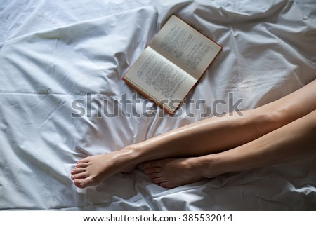 Book by the female legs #385532014