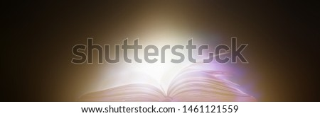Book in library with old open textbook, stack piles of literature text archive on reading desk, and aisle of bookshelves in school study class room background for academic education learning concept #1461121559