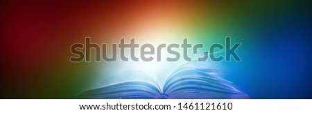 Book in library with old open textbook, stack piles of literature text archive on reading desk, and aisle of bookshelves in school study class room background for academic education learning concept #1461121610