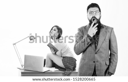 Book keeping startup costs. Blurred shocked businessman with sexy lady sitting on desktop. Sensual office manager in startup company. Running startup business. Startup project managers in office.