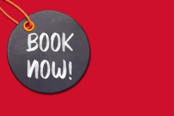 book now on circle tag isolated on red background. Concept activity of asking for goods or services