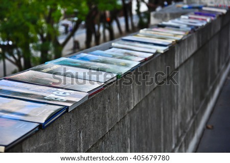 Book of bouquinistes  on the river of Seine in Paris. in Paris, France. stock photo