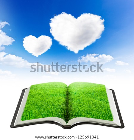 book of nature with grass over beauty sky background with two hearts shape