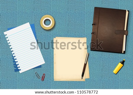 Book, office papers and pen