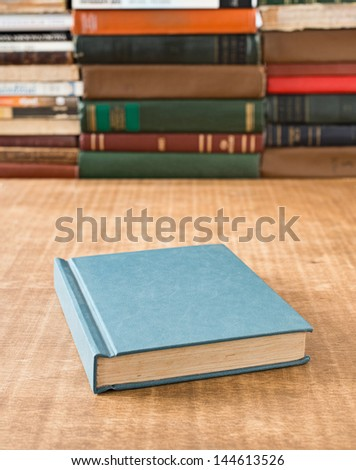 Book on the table in shallow focus.