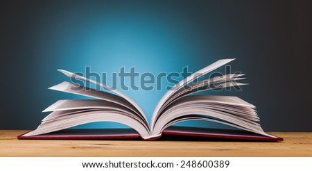 book on wooden table  with blue background