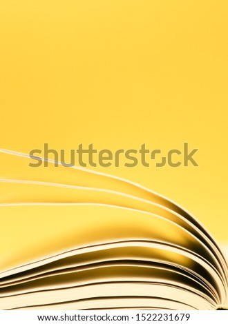Book pages turning, Pages turning over a yellow background