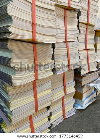 Book piles on the gray floor. Stockfoto ©