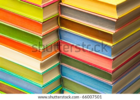 Book set background. Stack of colored hard covered used books