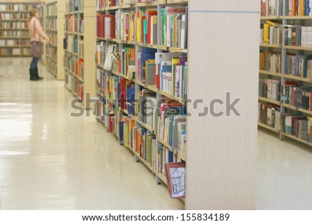 Book shelves in public library, shallow DOF