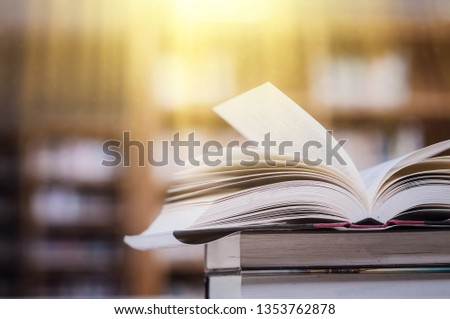 Book stack in the library and blurred bookshelf background for education. education background. back to school concept.