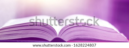 Book stack in the library and blurred bookshelf background for education. Education background. Back to school  concept. Open book design for decorate wallpaper and learning classroom.