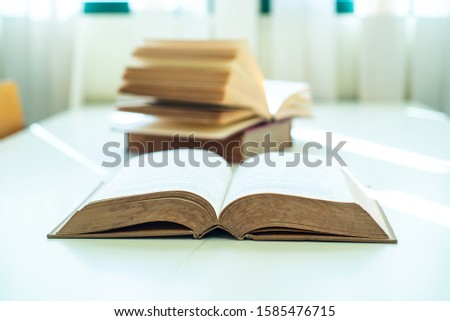 Book stack on table in the library room, business and education background concept