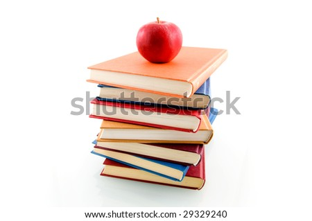 Book stack with an apple isolated on white background