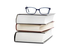 Book stack with eye glasses