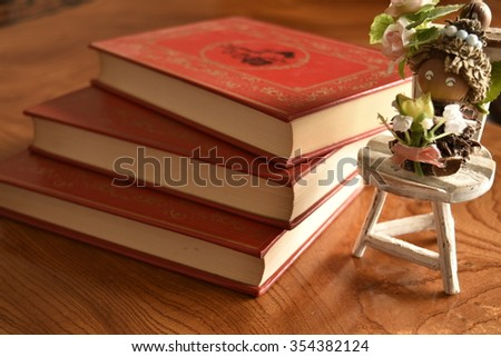 Stock Photo Book with a red cover three books with a toy man