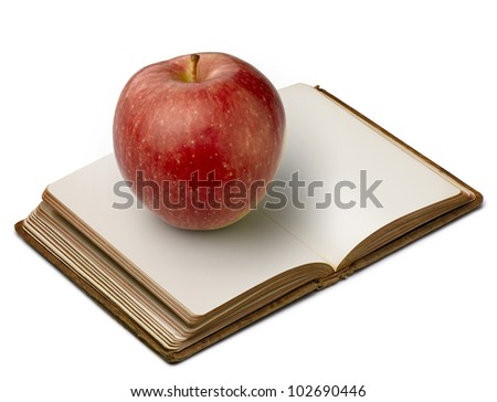 Book with apple (clipping path ) on white background