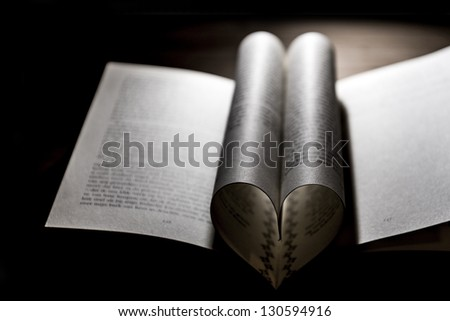 book with heart shape folded papers. low key image.