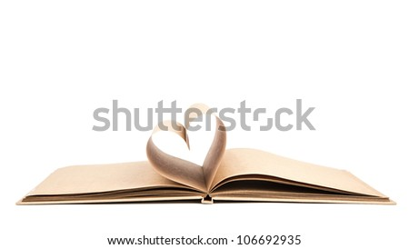 Book with opened pages of shape of heart isolated on white background