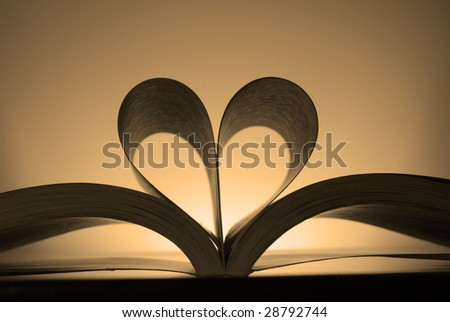Book with pages turned into the shape of a heart - stock photo