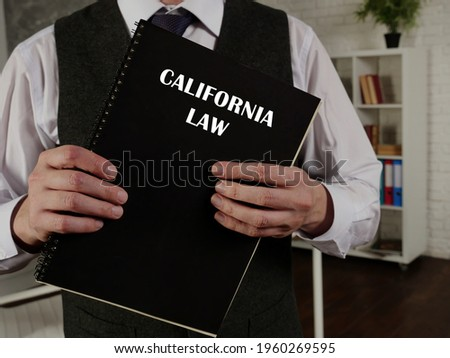 Book with title CALIFORNIA LAW . California residents are subject to California state and U.S. federal laws