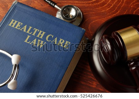 Book with title Health Care Law on a table. #525426676