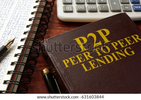 Book with title P2P peer to peer lending on a table.  #631603844