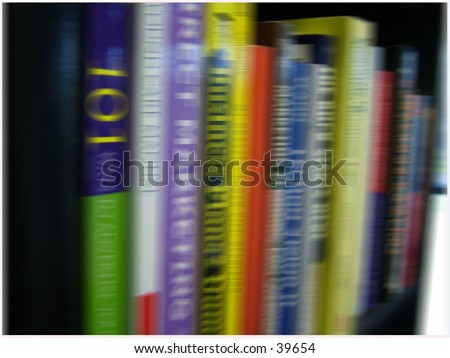 bookcase full of business reference material
