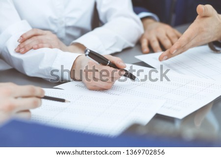 Bookkeepers team or financial inspectors  making report, calculating or checking balance. Group of people at work. Business operations concept