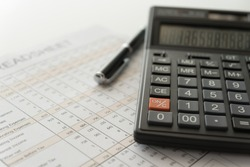 bookkeeping accounting concept. calculator on financial statement and balance sheet annual.