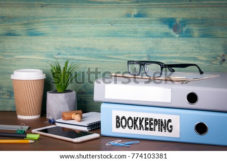 bookkeeping concept. Binders on desk in the office. Business background
