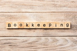 bookkeeping word written on wood block. bookkeeping text on table, concept.