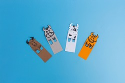 Bookmarks with bull or cow on blue background, handmade paper craft for kids