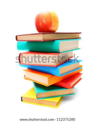 Books and a red apple. On white background.