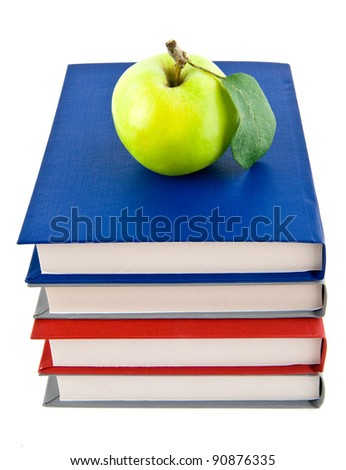 books and apple on a white background